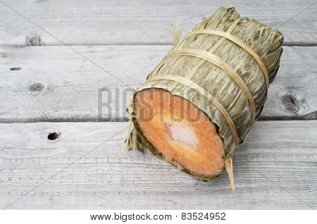 Vietnamese Conical Sticky Rice Cake Stuffed With Pork Belly On Wooden Background