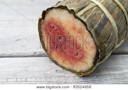 Vietnamese conical sticky rice cake stuffed banana on wooden background