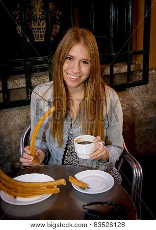 American Student Tourist Girl Sitting Having Spanish Typical Hot Chocolate With Churros Smiling Happ