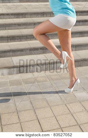 Girl's Long Legs - Stock Photo