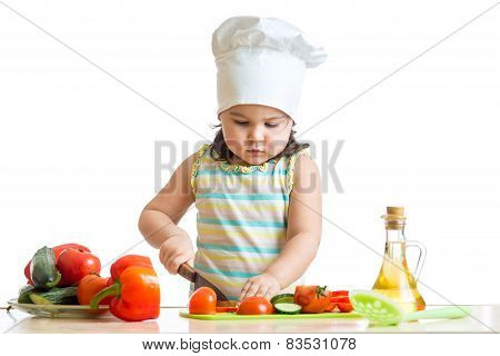little girl helping at kitchen with salad making