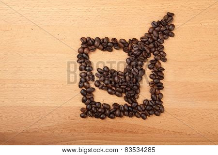 Roasted Coffee Beans In Check Mark In Box Shape