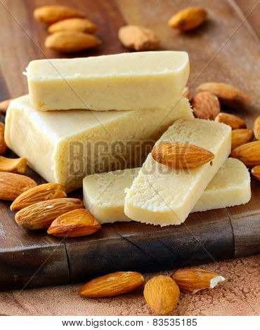 Marzipan almonds bar  bread , wish fresh almond on a wooden board