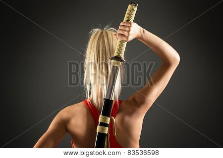 Rear View Of  Woman With Sword