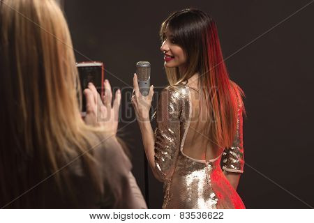 Photographing Woman Singer