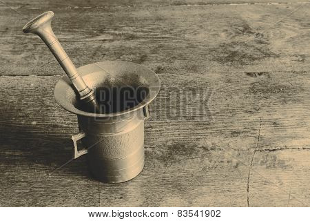 Old Bronze Mortar With Pestle On Wootden Table