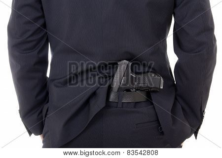 Man Concealing Gun In Pants Behind His Back Isolated On White