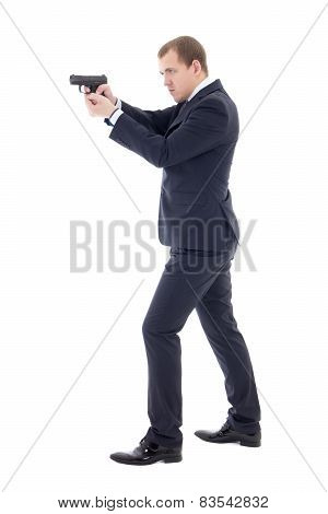 Secret Agent Man In Business Suit Posing With Gun Isolated On White