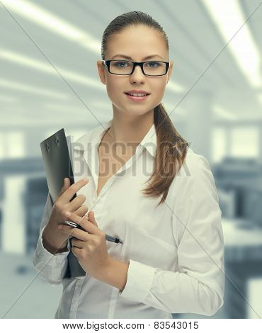 Young woman secretary at work at the office
