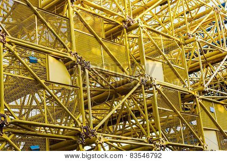Stacked Disassembled Building Cranes Background