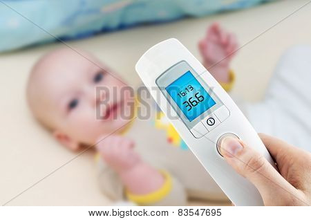 Measuring Temperature To A Baby With Digital Thermometer
