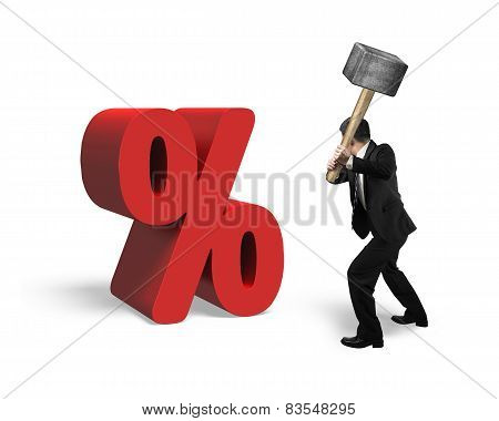 Businessman Holding Sledgehammer Hitting Red Percentage Sign Isolated On White