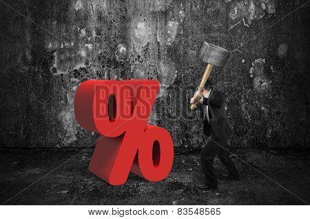 Businessman Holding Sledgehammer Hitting Red Percentage Sign With Dark Room