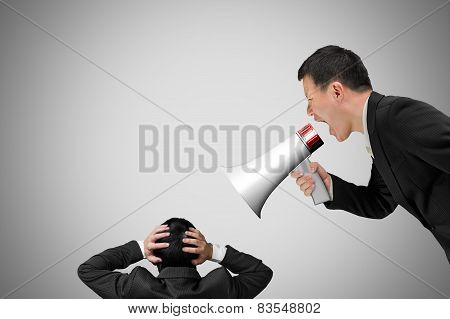 Boss Using Megaphone Yelling At His Employee With Concrete Wall