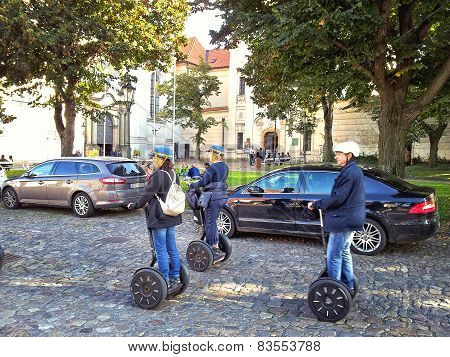 Three Tourists Travel Prague On Segways