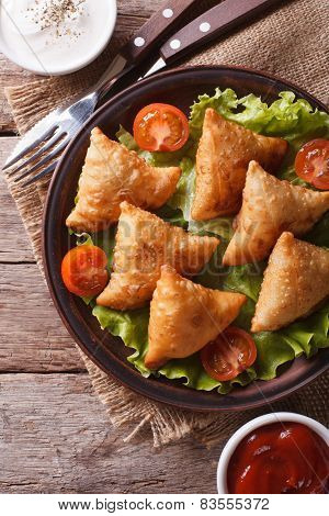 Samosa On A Plate With Sauce Closeup, Vertical Top View