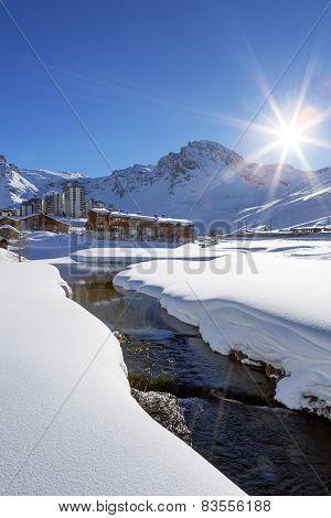 Tignes Village With Sun And Creek