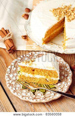Carrot Cake With Spices On A Wooden Table