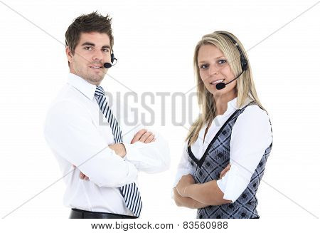 Young employee working with a headset and accompanied by his team