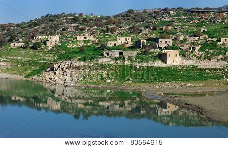 Reflection of  beautiful rural landscape in  deep lake mountains