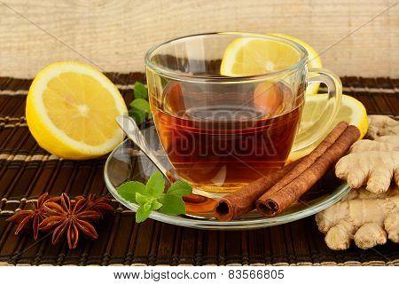 Ginger Tea-ingwertee On Brown Mat With Lemon