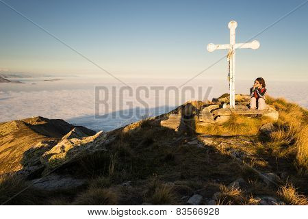 Woman Resting On The Mountain Top