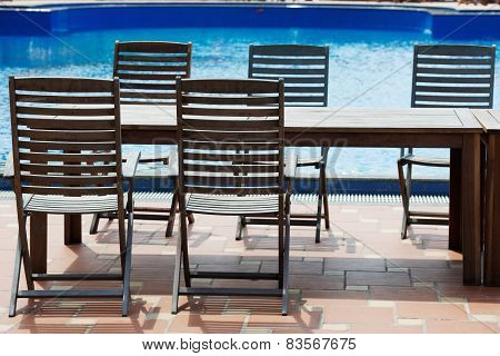 Table and chairs on poolside