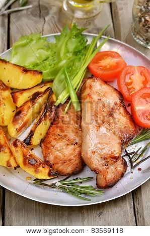 Roasted Pork Chop With Baked Potatoes