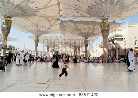 People In The Courtyard Of The Mosque Of The Prophet In Medina Saudi Arabia