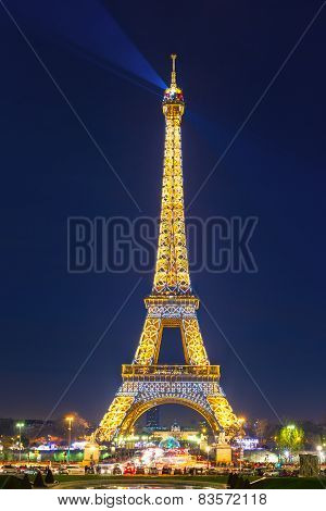 Shimmering Eiffel Tower at night in Paris,  France