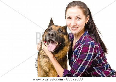 Smiling young woman  and German shepherd