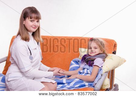 Pediatrician Holding A Sick Child's Hand