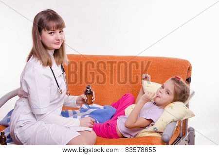 Doctor Holding A Medicine For Little Girl