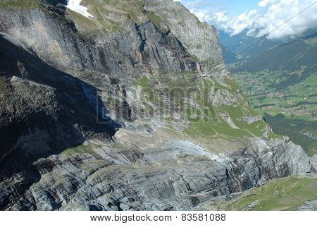 Rocky Mountainside In Valley Nearby Grindelwald In Switzerland.