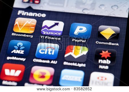 Close-up image of an iPhone screen with icons of finance apps