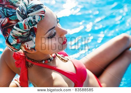 Beautiful Fashionable Woman Near The Pool
