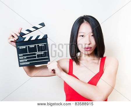 Young Beautiful Asian Woman Holding Clapperboard White Background