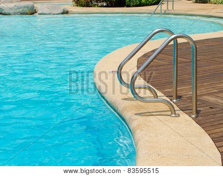 Blue Swimming Pool With Staircase At Hotel