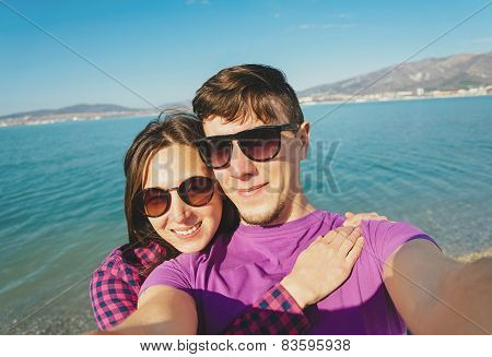 Loving Couple Taking Photographs Self-portrait On Beach