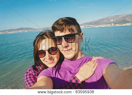 Loving Couple Taking Photographs Self-portrait On Beach