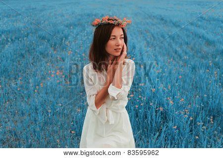 Beautiful Woman Resting On Summer Meadow