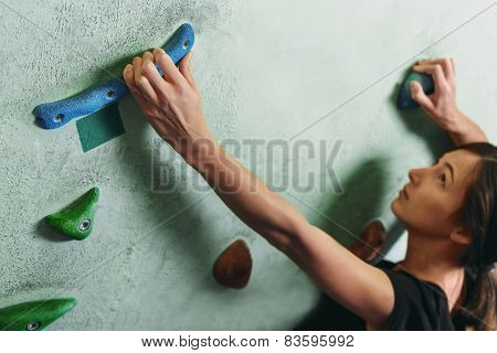 Girl Climbing Up On Rock Wall Indoor