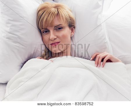 Woman smiling in bed