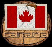 stock photo of canada maple leaf  - Flag of Canada in a old photo frame with wooden text canada on a section of tree trunk isolated on black background - JPG