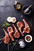 picture of ribs  - Raw meat mutton lamb ribs with herbs on black marble background - JPG