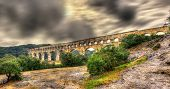 image of aqueduct  - Pont du Gard ancient Roman aqueduct UNESCO site in France - JPG