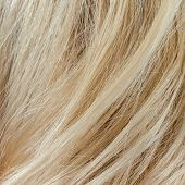 pic of hair streaks  - Wavy blonde woman hair background and texture - JPG