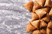 picture of samosa  - Indian samosa pastry on a floured table - JPG