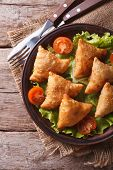 pic of samosa  - delicious pastry samosas on a plate close - JPG