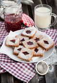 pic of linzer  - Homemade Linzer cutout jam filled cookies on table - JPG